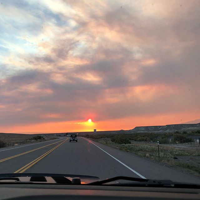 Heading home into the [very smoky] sunset.  Praying for the firefighters working on the Bull Draw fire up on the Uncompaghre Plateau. Reports say it's 70% contained as of yesterday, & the smoke was from their efforts to create a fire break & reduce fuels for the wildfire. . . #sunset #coloradosunset #wildfire #jeeping #bulldrawfire