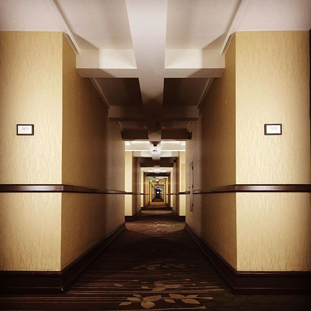 Looking down a long, dark-ish hallway…….